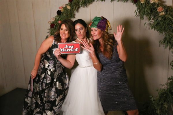Bride and guests having fun in the photobooth!
