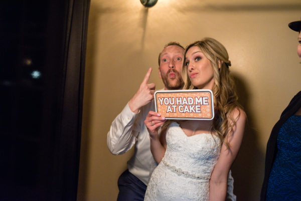 Bride and Groom in their wedding photobooth